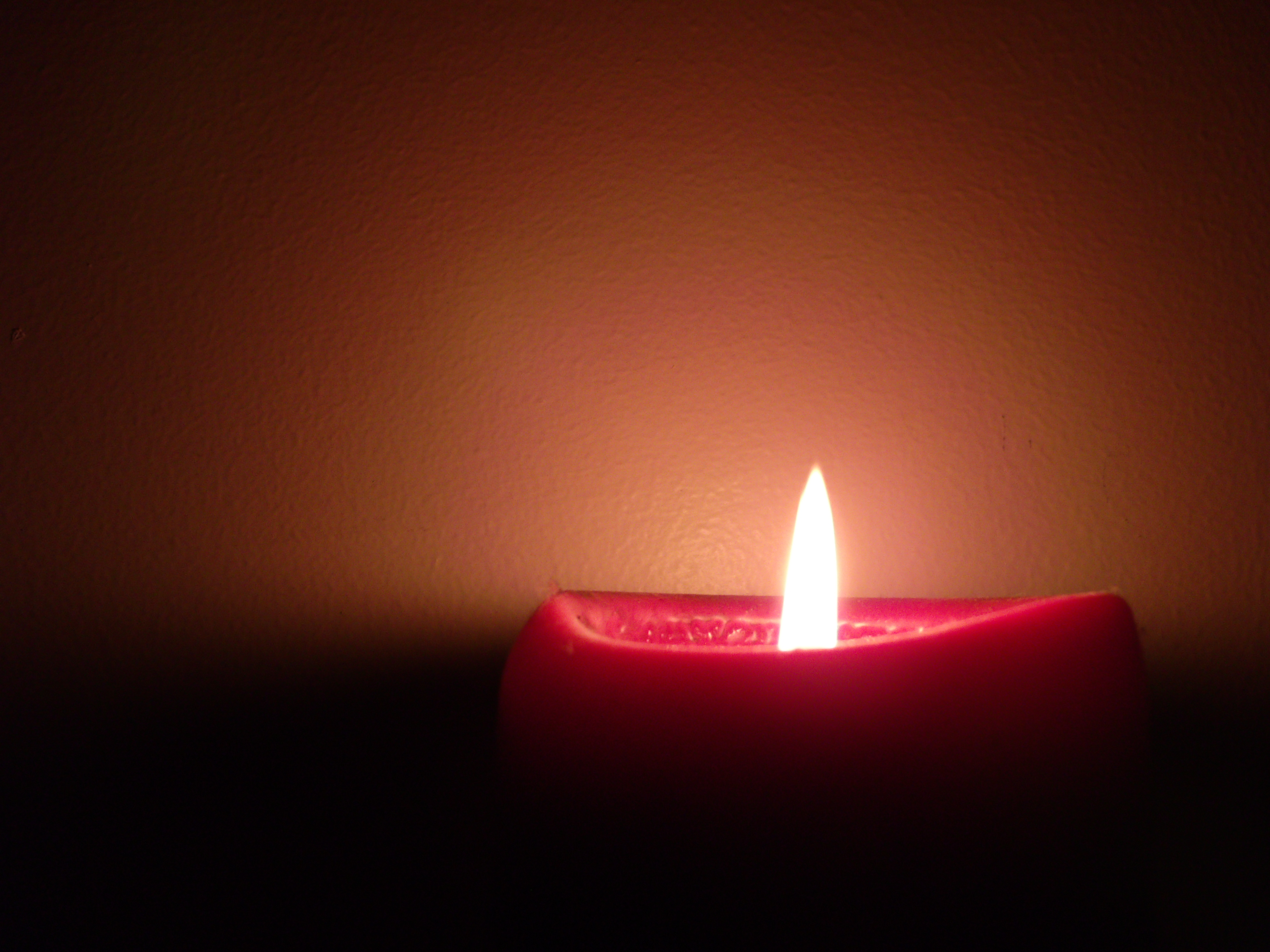 Dark room with candle light - Is