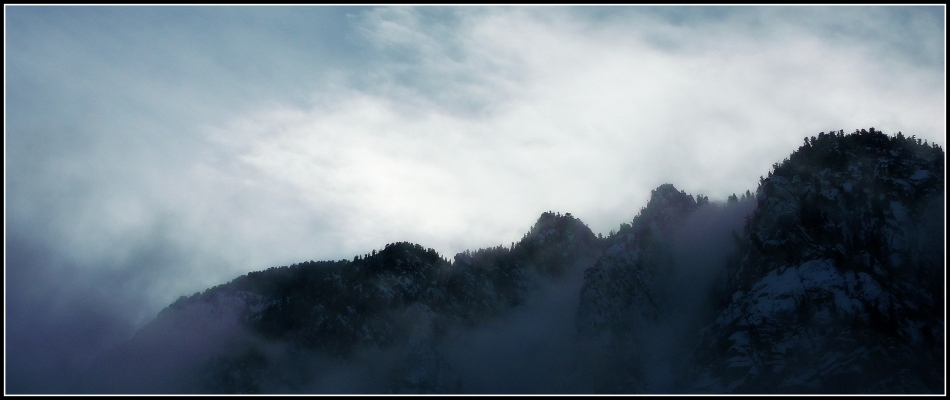 Clouds on Mountain Ridge-line