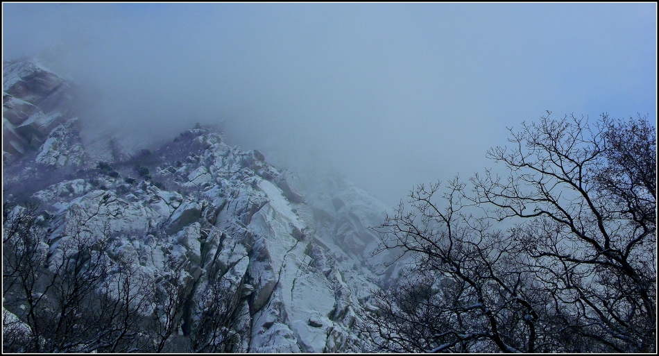 Granite mountain in clouds