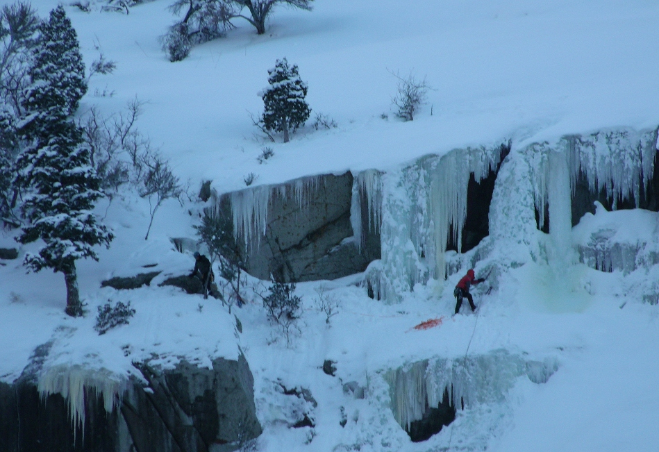 Ice Climber placing anchor Little Cottonwood Canyon Utah