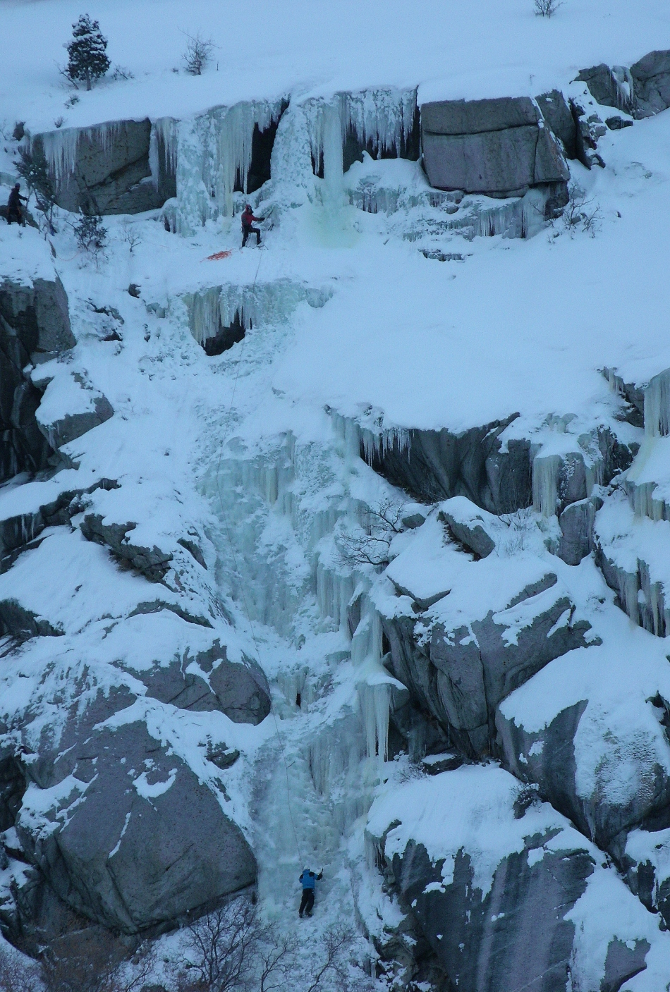 Ice Climbers at top and bottom of falls in Little Cottonwood Canyon Utah