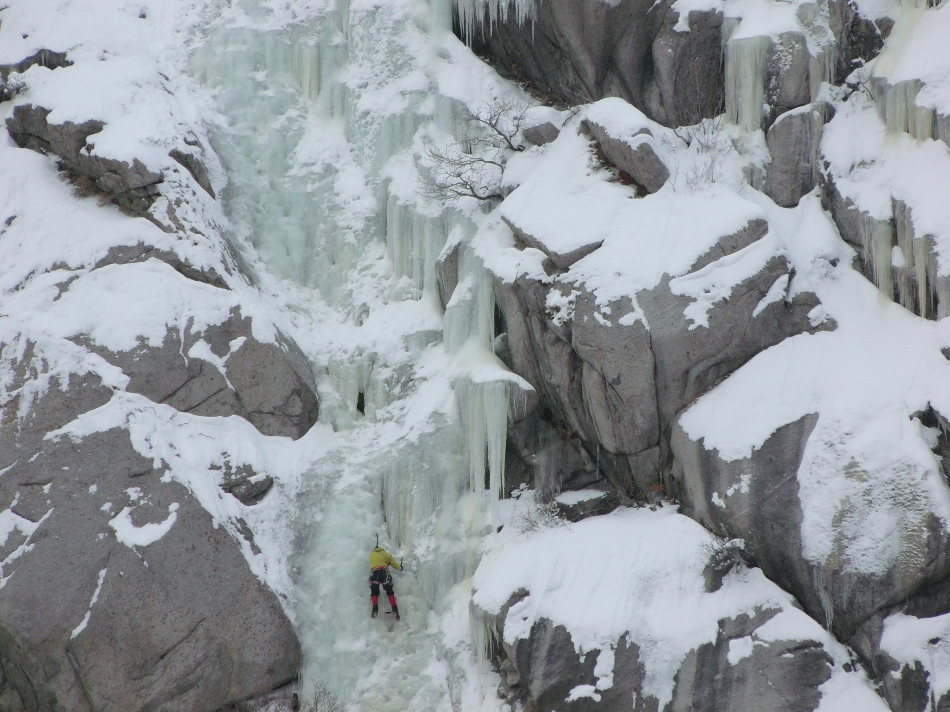 Solo ice climber close-up Little Cottonwood Canyon Utah