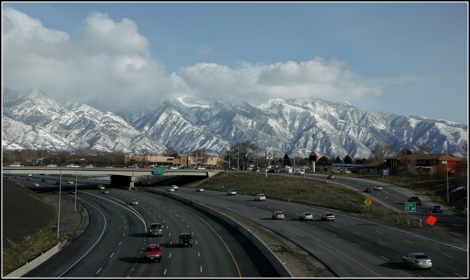 Eastbound exit at State Street on I-215 with Wasatch Mountains in Background