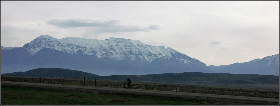 solitary Utah road-cyclist and mountains