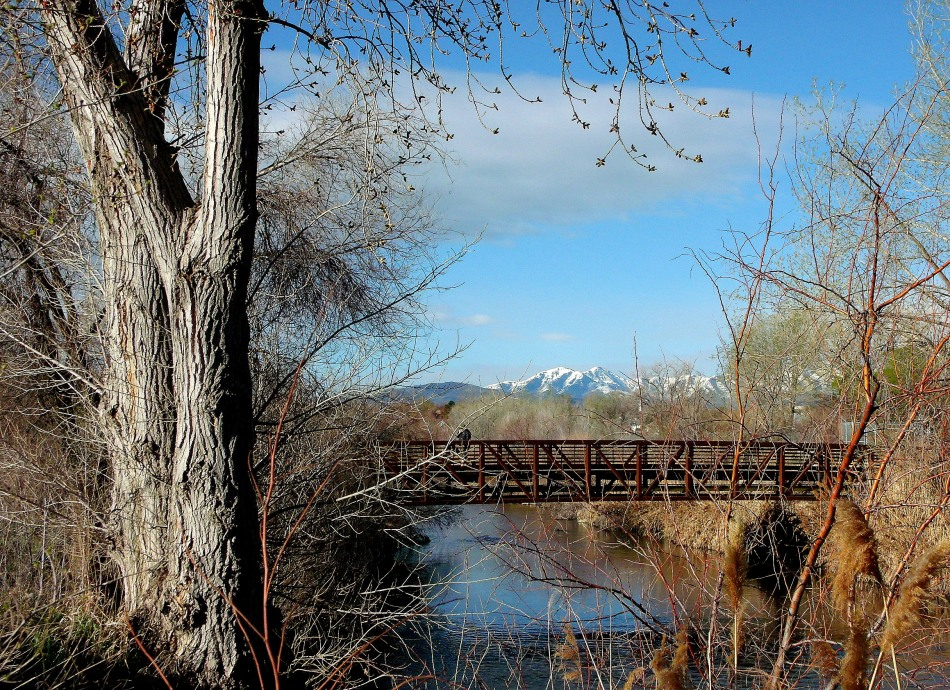 Oquirrh Mountains over Jordan River Walkway Bridge in April