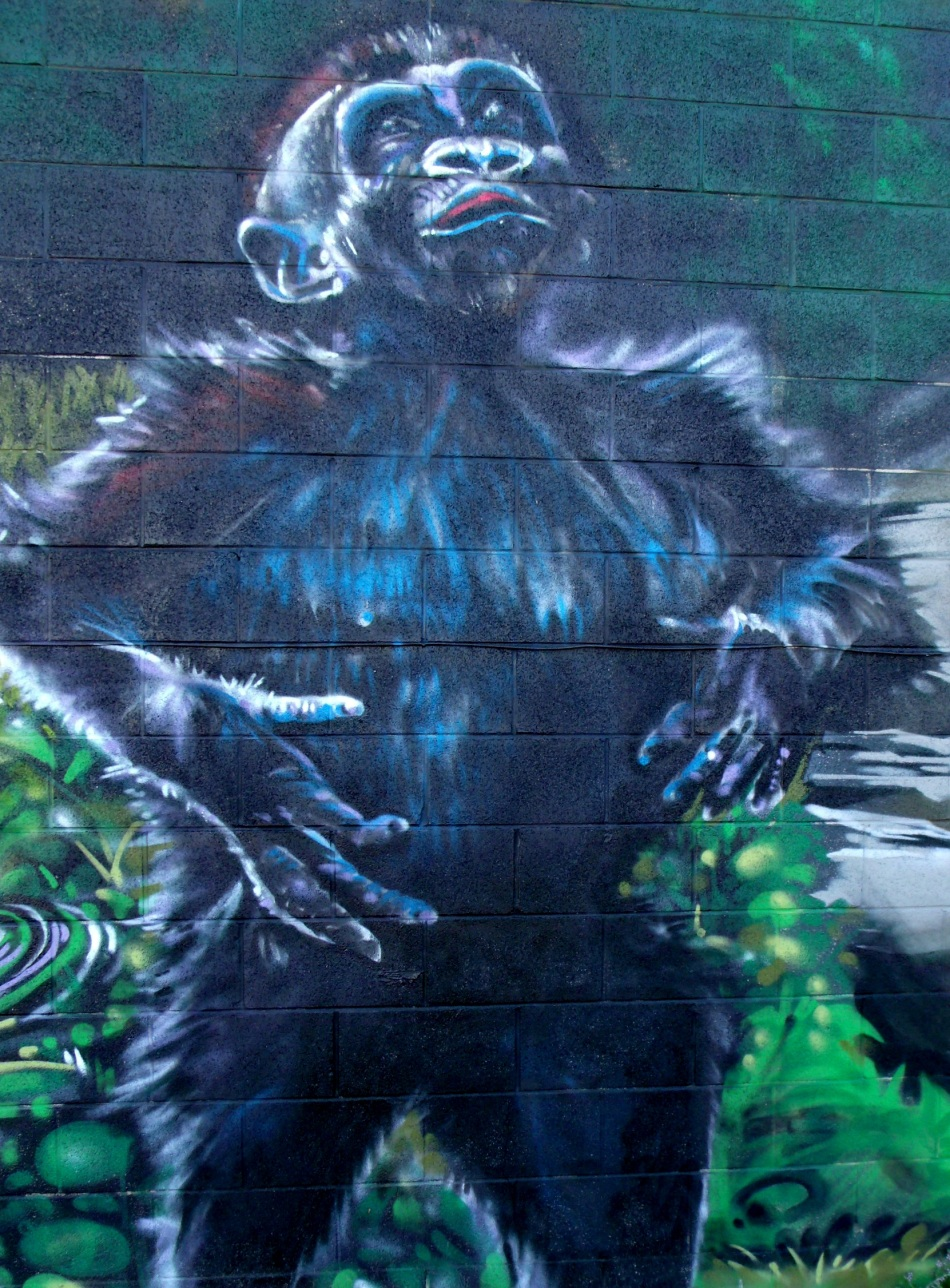 Urban Jungle Mural posturing juvenile gorilla