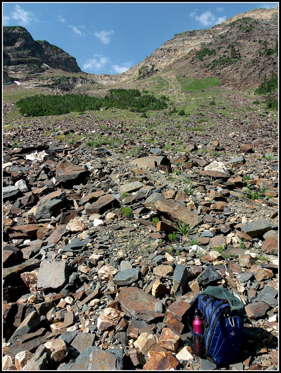Trail to the saddle with backpack