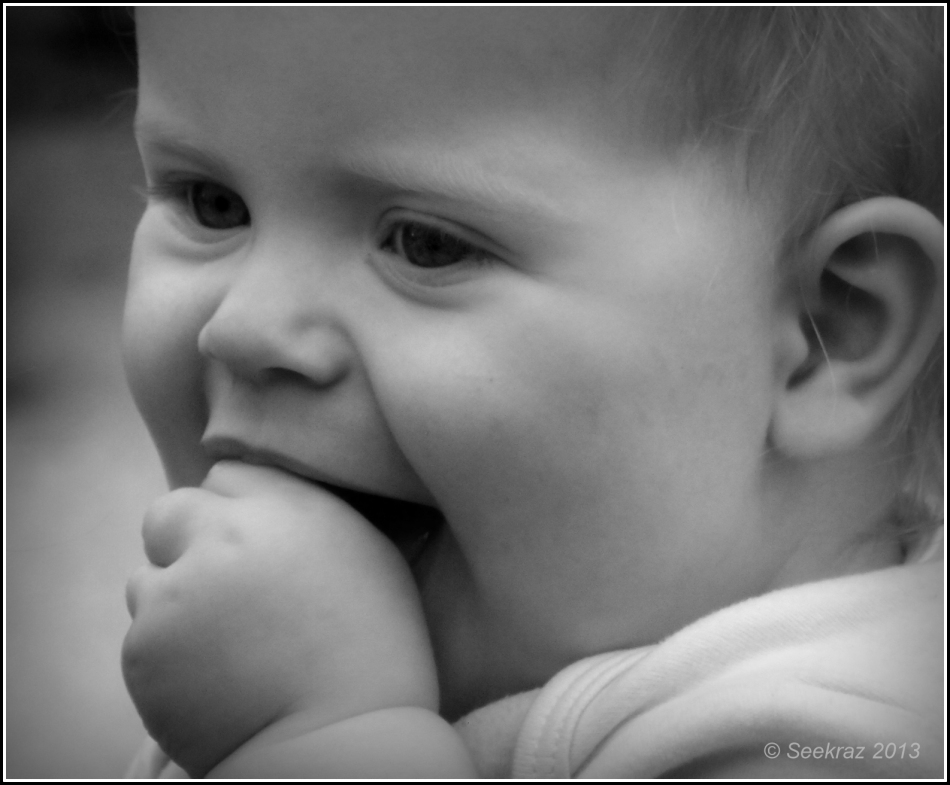 portrait of a baby in black and white