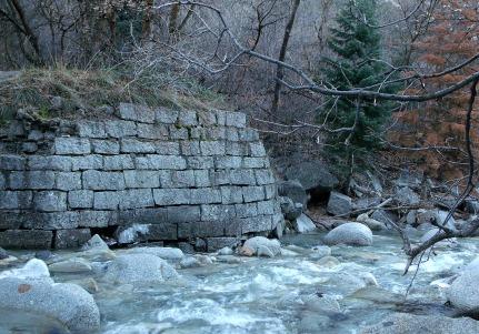 Hand-hewn granite wall along Little Cottonwood Canyon stream