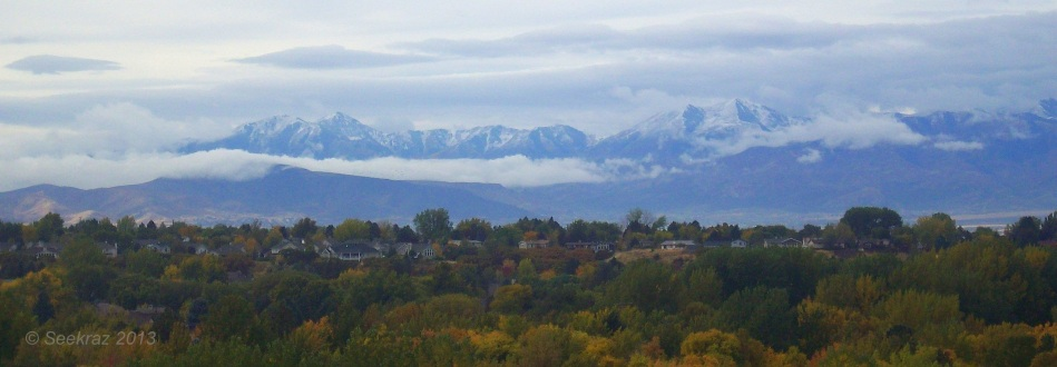 Oquirrh Mountains clouds and Fall-colored neighborhood