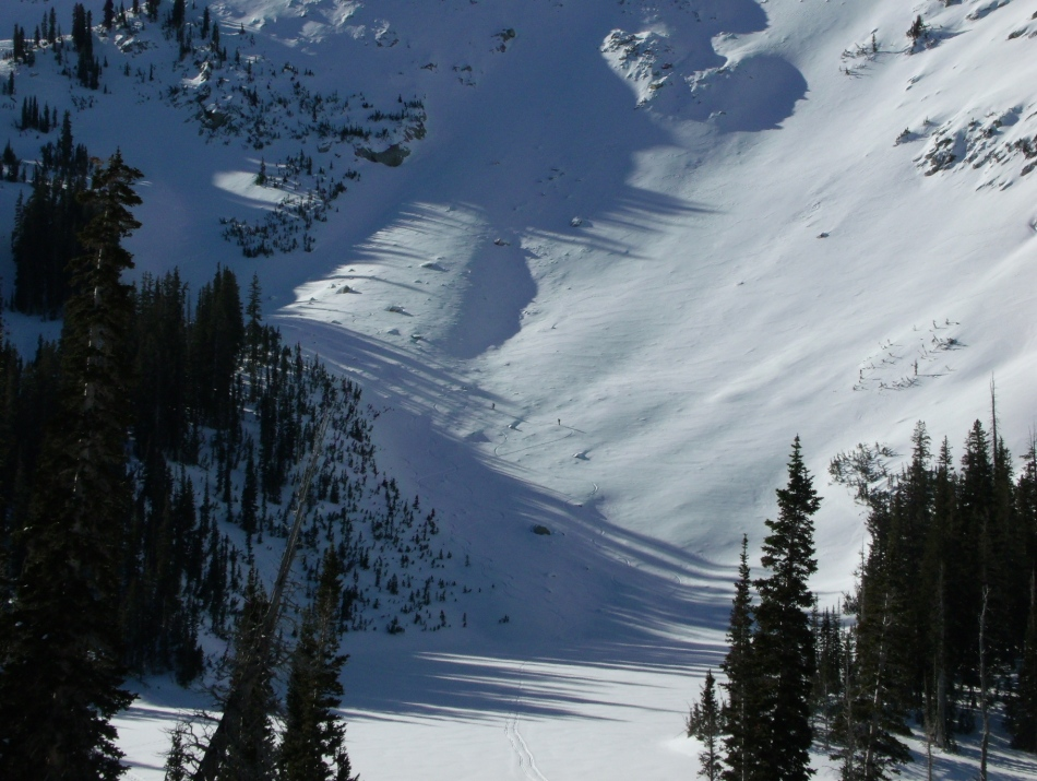 Skiers further up slope from Red Pine Lake