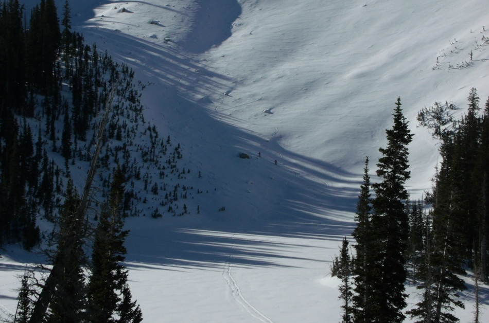 Skiers going up slope from Red Pine Lake