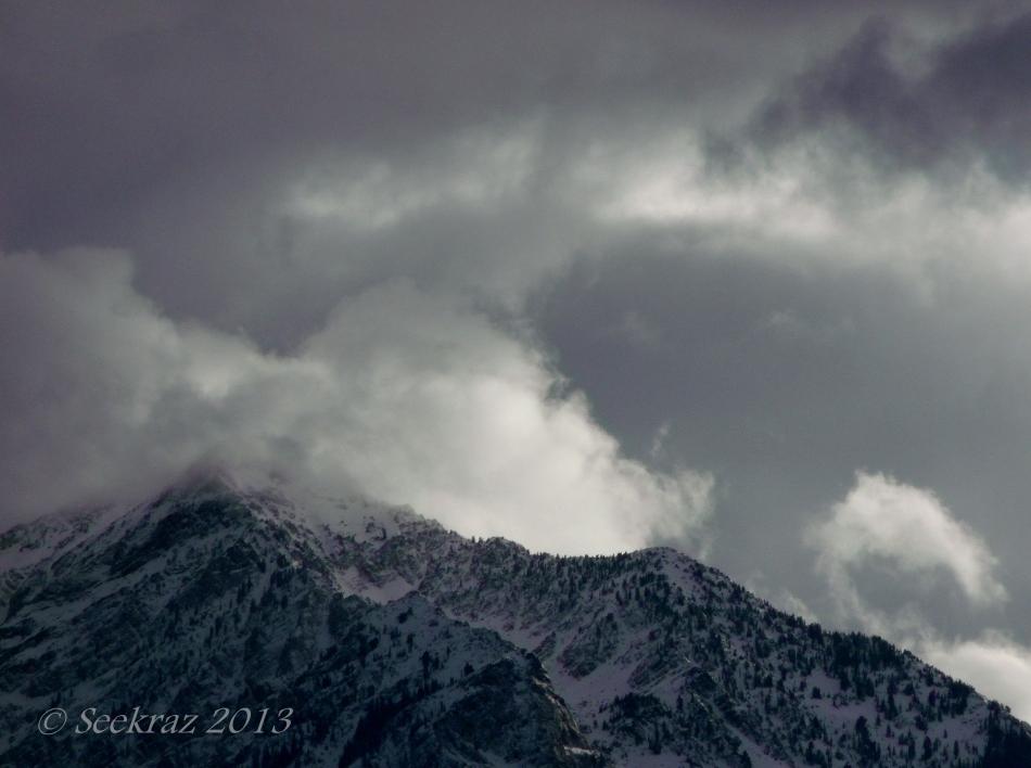 Snowy Twin Peaks  under Clouds