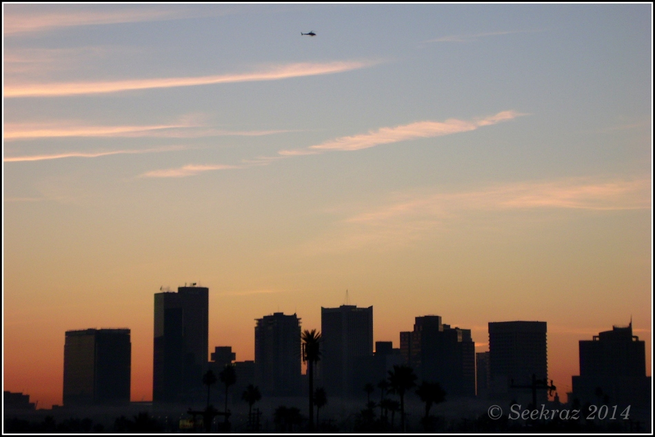 media helicopter over Phoenix morning skyline