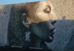 Indigenous woman mural closer atsunrise