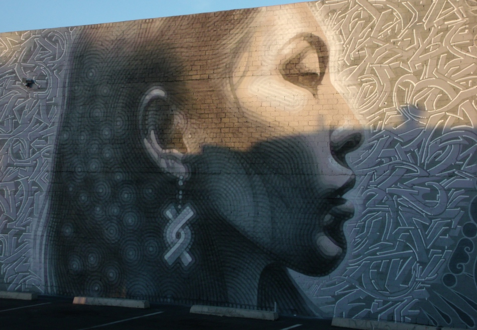 Indigenous woman mural closer at sunrise