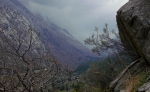 Cliff-side with low clouds in Little CottonwoodCanyon