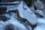 Ice blanket on rock in Little Cottonwood Canyonstream