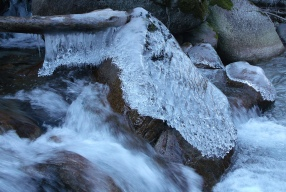 Ice blanket on rock in Little Cottonwood Canyon stream