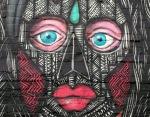 full face of blue eyes andmask