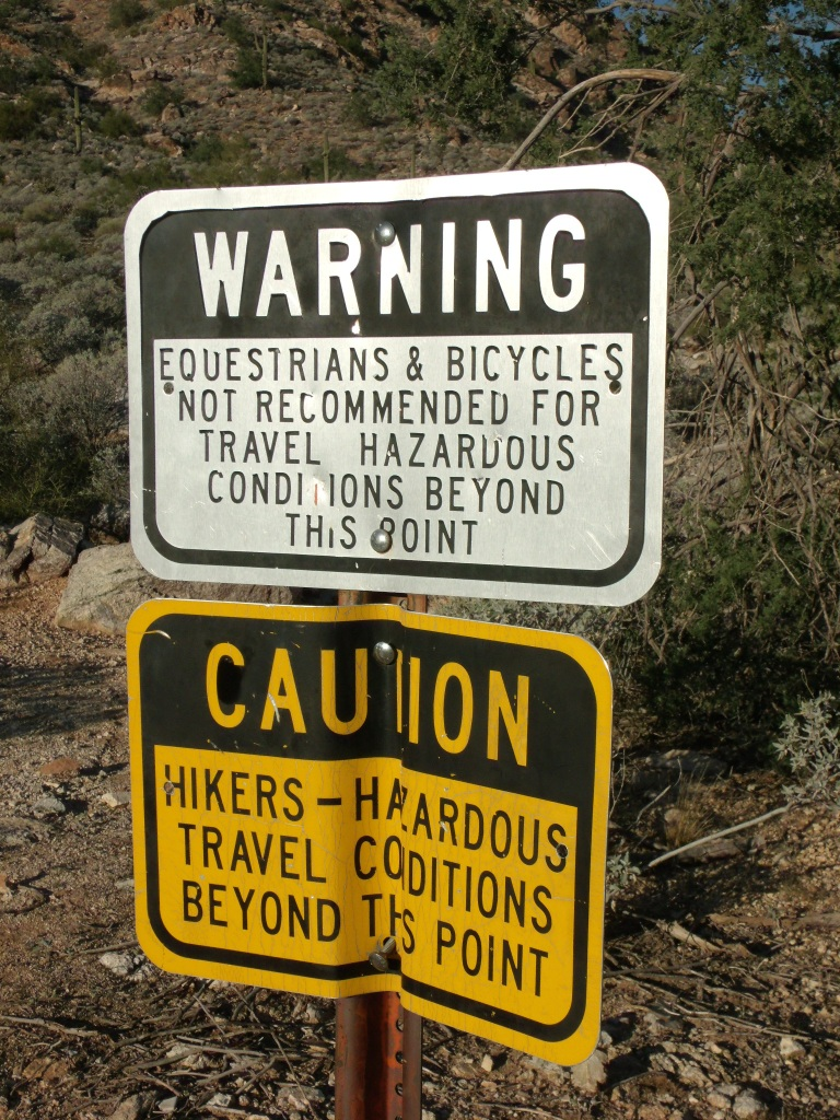 Hikers-Beware sign at entrance of Ford Canyon in White Tank Mountains