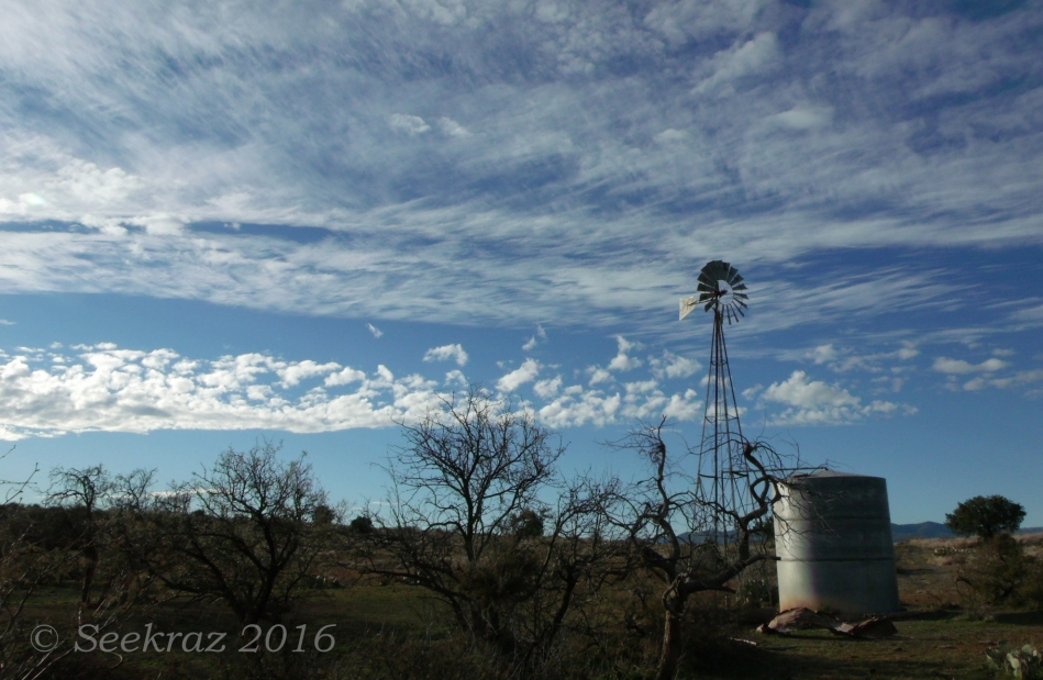 Cloudy sky with windmill along Drinking Snake segment of Black Canyon Trail