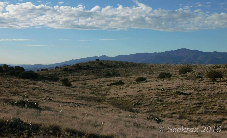 Rolling hills, mountains, and clouds along Drinking Snake segment of Black Canyon Trail