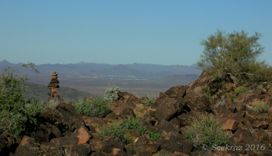 A cairn and Lake Pleasant from atop the Tramonto Hills