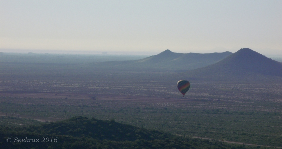 Looking south at hot-air balloon over the desert