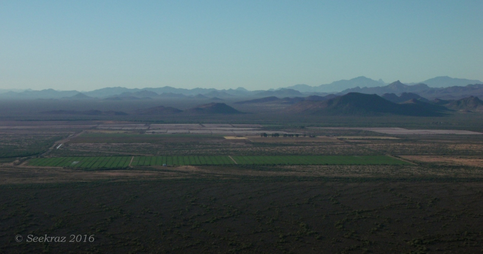 Looking south at desert fields and desert hills