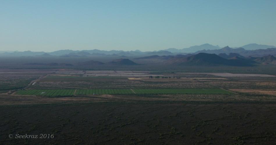 Looking south at desert fields and desert hills