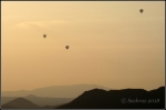 Three in flight over deserthills