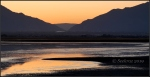 Approaching sunrise in Wasatch Mountains reflected in Great SaltLake