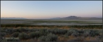 Distant Antelope Island with sage foreground approachingsunrise