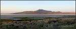 Sunrise glow on Antelope Island viewed fromcauseway