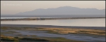 Low water level of Great Salt Lake with Wasatch Mountains in background atsunrise