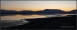 Wasatch Mountains reflected in Great Salt Lake from Antelope Islandcauseway