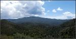 Clouds gathering over high desert forestedmountains