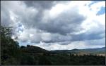 Darkening clouds over high desert forestedmountains