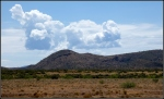 Forming anvil cloud over high desert hills and nearfields