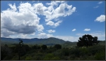 Gathering clouds over high desert mountains and nearground