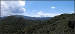High desert forested mountains and cloudspanorama